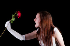 Redhead screaming at rose Royalty Free Stock Images