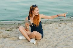 Redhead woman with tablet computer. Redhead woman with tablet computer on a beach royalty free stock images