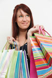 Redhead with shopping bags Stock Photo