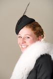 Redhead smiling in black hat and fur. Redhead smiling in a black hat and fur Stock Photo