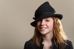 Redhead smiling in black hat and jacket Stock Photography