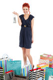 Redhead standing with shopping bags stock photography