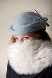Redhead staring in blue veiled hat and fur Royalty Free Stock Images