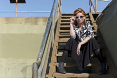 Redhead on the steps Royalty Free Stock Image