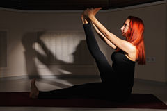 Redhead stretching leg Royalty Free Stock Photos