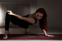 Redhead at stretching pose Stock Photos
