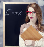 Redhead student near blackboard. Royalty Free Stock Images