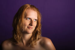 Redhead in the studio. Redhead in studio looking to the side Royalty Free Stock Image