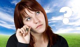 Redhead sveglio nel dilemma Immagini Stock