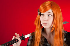 Redhead with sword Royalty Free Stock Photography