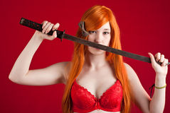 Redhead with sword Stock Photo