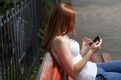 Redhead with tablet pc outdoors Royalty Free Stock Photos