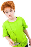 Redhead teen. Listens to music Royalty Free Stock Image