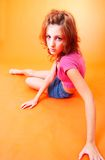 Redhead Teen 3. Redheaded teenage girl leaning on her hip toward camera and braced by one arm.  Serious expression Stock Images