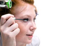 Redhead teen girl doing makeup Stock Photos
