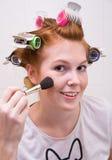 Redhead teen girl doing makeup royalty free stock photo