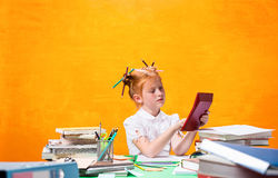 The Redhead teen girl with lot of books at home. Studio shot Stock Image