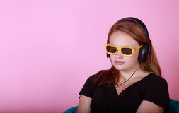 Redhead teen with headphones Stock Images