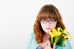 Redhead Teen holding yellow flowers Royalty Free Stock Image