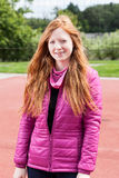 Redhead teenage girl in pink Royalty Free Stock Photos
