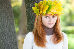 Redhead teenager woman in a wreath Royalty Free Stock Images