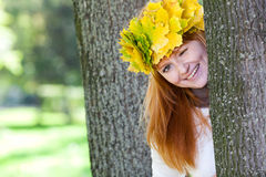 Redhead teenager woman in a wreath Royalty Free Stock Photo