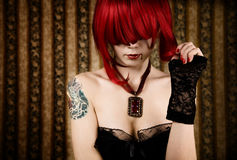 Redhead vampire with drop of blood Royalty Free Stock Photo