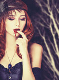 Redhead vampire woman Stock Images