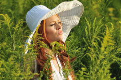 Redhead wearing a wide brim hat Stock Photo