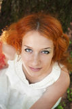 Redhead in white Royalty Free Stock Photography