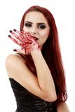 Redhead witch blood on hands Stock Image