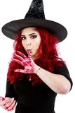 Redhead witch blood on hands Royalty Free Stock Photos