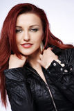 Redhead woman. Portrait of young beautiful redhead woman royalty free stock photos