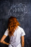 Redhead woman asking when Royalty Free Stock Images
