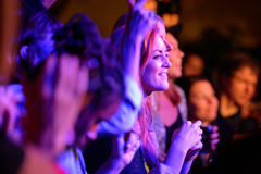 A redhead woman from the audience applauding at Barcelona Accio Musical (BAM) Royalty Free Stock Image