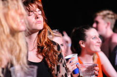Redhead woman from the audience applauding at FIB Stock Photography