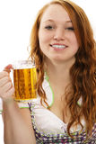 Redhead woman in bavarian dress and a glass with b Stock Photography