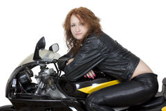 Redhead woman on a bike Royalty Free Stock Image