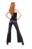 Redhead woman in black bell bottom pants Stock Photography