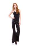 Redhead woman. In black bell bottom pants on white royalty free stock images