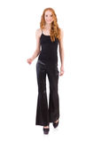Redhead woman in black bell bottom pants Royalty Free Stock Image