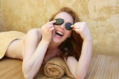 Redhead woman with black stones treatment Stock Image