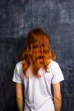 Redhead woman by blank blackboard. Redhead woman standing by blank blackboard Stock Photo