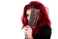Redhead woman with a bloody hatchet in hand Royalty Free Stock Photo