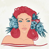 Redhead woman with blue flowers in her hair Royalty Free Stock Photos