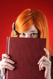 Redhead woman with book Royalty Free Stock Photography