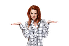 Redhead woman can't decide Royalty Free Stock Photos