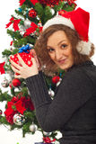 Redhead woman with Christmas gifts near tree Royalty Free Stock Photography