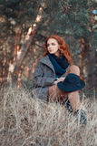 Redhead woman with curly hair outdoors Royalty Free Stock Images