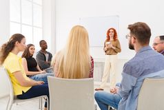 Redhead woman doing presentation in office. Redhead women doing presentation in office, copy space. Startup business meeting, sharing new ideas to partners stock image